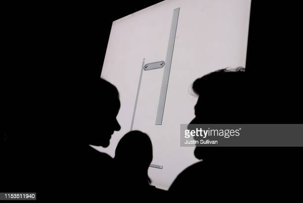 An image of the new Apple Pro Display and Pro Stand is displayed during the 2019 Apple Worldwide Developer Conference at the San Jose Convention...