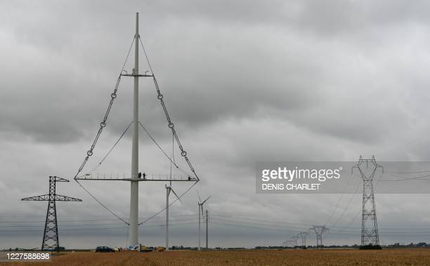 An image of the new electricity pylon installed by RTE near the town of Flers in Escrebieux, northern France on July 16, 2020. - A central mast and a...