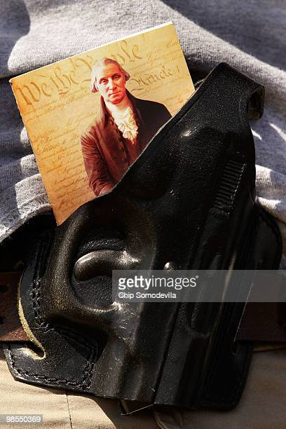 An image of the US Constitution and President George Washington is stuffed into a gun holster during a progun rally near the Washington Monument...