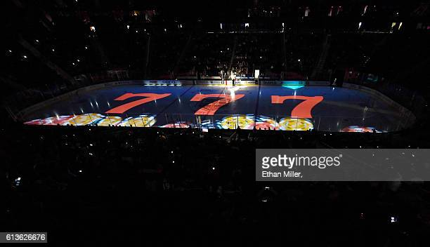 An image of three sevens on a slot machine is projected on the ice before a preseason game between the Colorado Avalanche and the Los Angeles Kings...