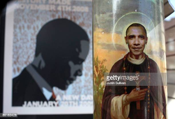 "An image of U.S. President Barack Obama depicted as a saint is seen on a two foot tall votive candle displayed in the window of ""Just For Fun"" March..."