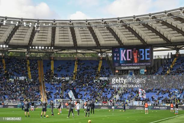 An image paying homage to late NBA legend Kobe Bryant is displayed on the stadium screen prior to the Italian Serie A football match Lazio Rome vs...