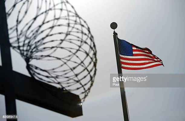 An image reviewed by the US military shows a US flag flying above a razorwiretopped fence at the Camp Six detention facility December 10 2008 on US...