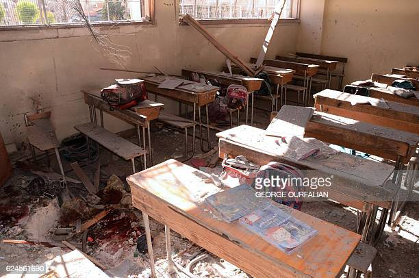TOPSHOT An image shows a pool of blood and damage at a classroom after it was reportedly hit by rebel rocket fire in the Furqan neighbourhood of the...