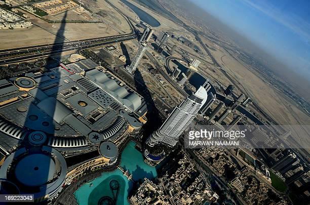 An image taken from Burj Khalifa the world's tallest skyscraper on May 21 2013 shows construction in Dubai As the economy of debtladen Dubai...