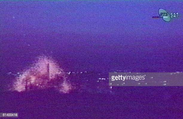 An image taken from Serbian television 04 April 1999 showing the explosion after NATO warplanes fired late 03 April 1999 a missile hitting the second...