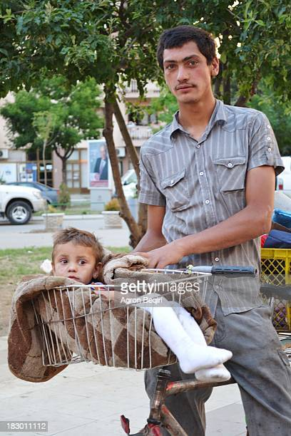 CONTENT] An image taken in Mitrovica the city of minners These two people old one and his son are from Roma hood in Mitrovica