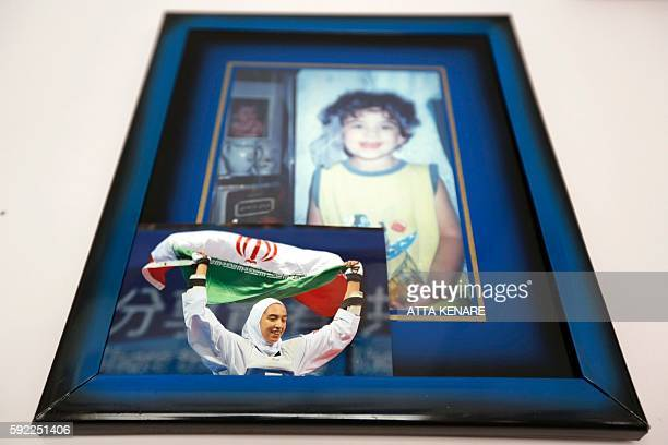 TOPSHOT An image taken on August 20 2016 shows a picture of Kimia Alizadeh who became the first Iranian woman ever to win an Olympic medal hanging in...