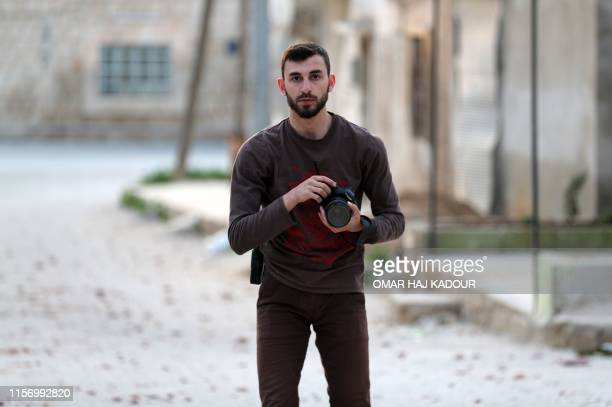 An image taken on February 25 shows Syrian citizen journalist Anas alDyab posing for a picture in the town of Khan Shaykhun in the southern...