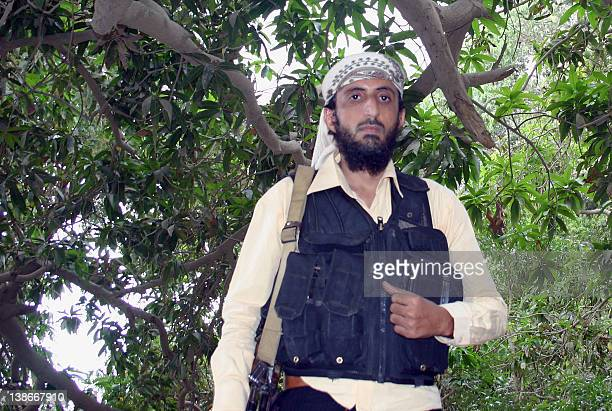 An image taken on January 21 2012 shows Jalal alBlaidy also known as Abu Hamza leader of the Ansar alSharia an AlQaeda affiliate group in Yemen in a...