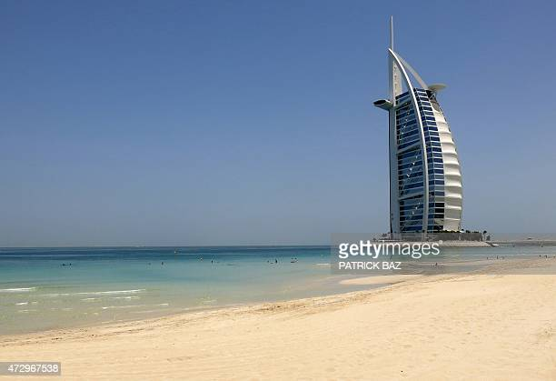 An image taken on May 11 2015 shows a view of the luxury Burj alArab Hotel at Jumeirah area in Dubai United Arab Emirates AFP PHOTO / PATRICK BAZ