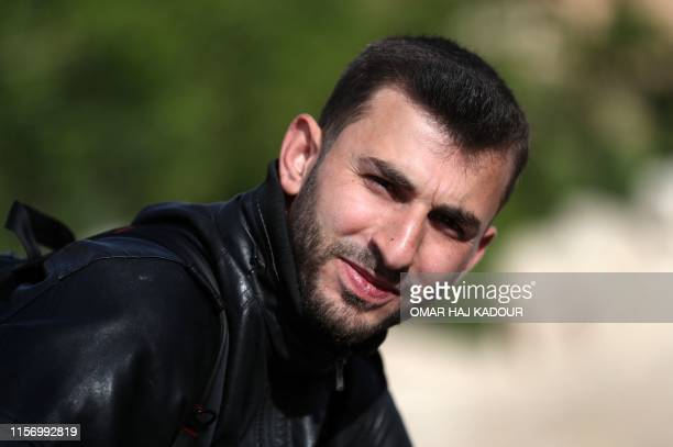 An image taken on May 9 shows Syrian citizen journalist Anas alDyab posing for a picture in the town of Khan Shaykhun in the southern countryside of...