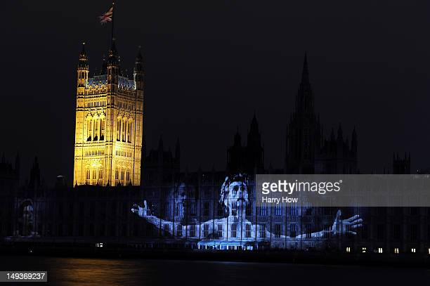 An images of Sebastian Coe is projected onto the House of Parlilament and Big Ben in a ceremony to mark the start of the 2012 Olympic Games on July...