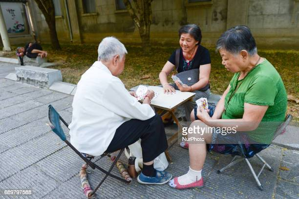 An images of three older ladies playing cards a typical scene from Wuhan center On Monday September 14 2016 in Wuhan China in