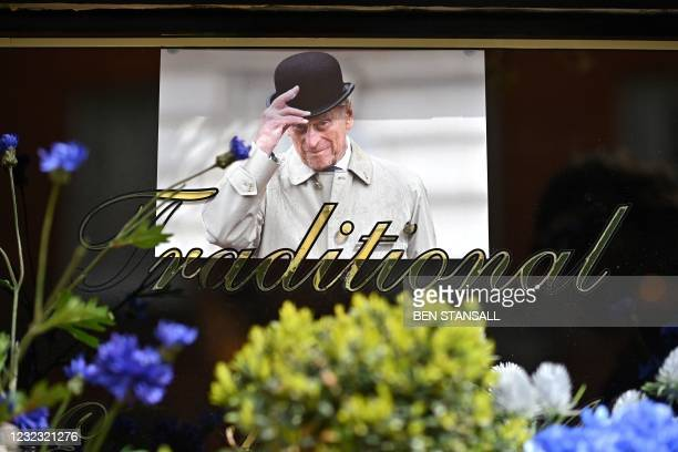 """An imagine of Britain's Prince Philip, Duke of Edinburgh is pictured above the word """"Traditional"""" in the window of a pub near Windsor Castle in..."""
