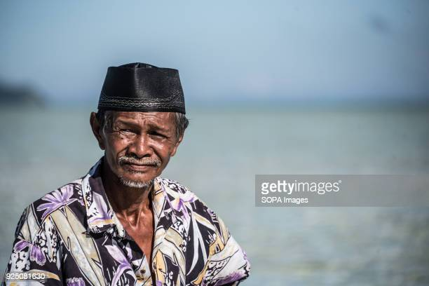 An Imam during a water festival held annually by the inhabitants of kalapuan Island. The festival is a purification ritual aimed at absolving...