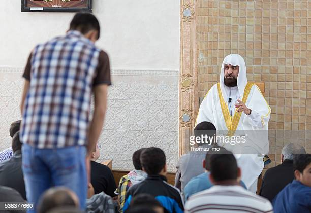An imam is holding the Friday prayer in a mosque on April 08 2016 in Sweileh Jordan