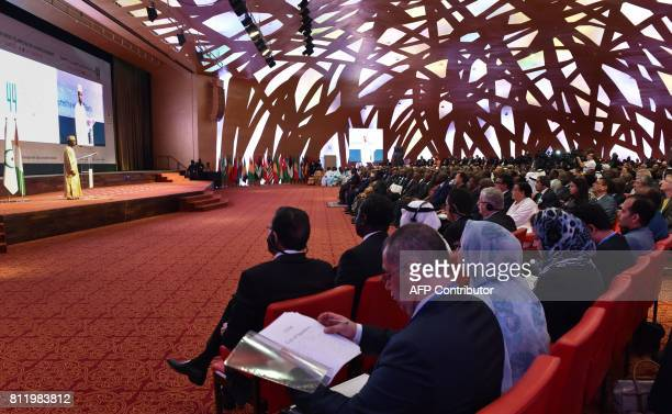 An Imam recites the Quran as Foreign Ministers and delegates attend the opening of the 44th meeting of the Ministers of Foreign Affairs of the...