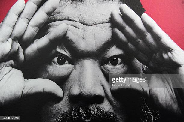An imgae depicting Chinese artist Ai Weiwei is displayed in Palazzo Strozzi on September 22 2016 in Florence Italy The exhibition 'Ai Weiwei Libero'...