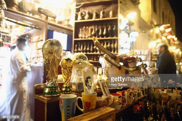 An imitation of the FIFA World Cup trophy is seen in a shop at Souq Waqifduring the FC Bayern Muenchen training camp on January 3 2018 in Doha Qatar