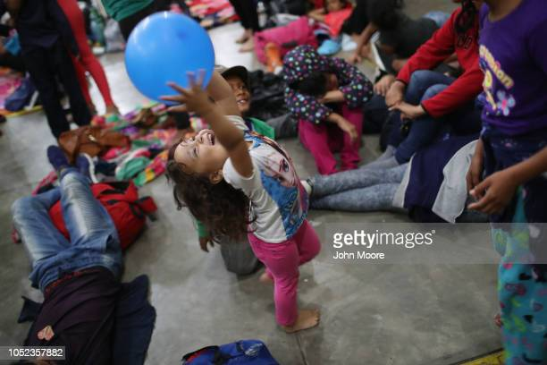 An immigrant child part of a migrant caravan of more than 1500 people mostly Honduran plays before sleeping in a community gym on October 16 2018 in...