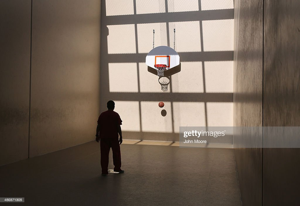 An immigrant detainee shoots hoops at the Adelanto Detention Facility on November 15, 2013 in Adelanto, California. The facility, the largest and newest Immigration and Customs Enforcement (ICE), detention center in California, houses an average of 1,100 immigrants in custody pending a decision in their immigration cases or awaiting deportation. The average stay for a detainee is 29 days. The facility is managed by the private GEO Group. ICE detains an average of 33,000 undocumented immigrants in more than 400 facilities nationwide.