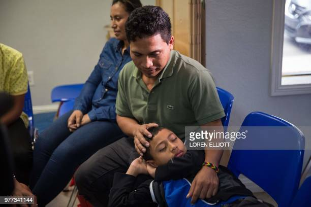 An immigrant from El Salvador and his 10yearold son pass the time after being released from detention through catch and release immigration policy at...