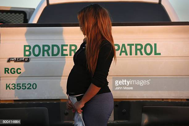An immigrant from El Salvador seven months pregnant she said stands next to a US Border Patrol truck after turning herself in to border agents on...