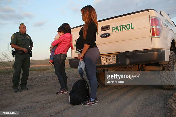 An immigrant from El Salvador seven months pregnant she said stands next to a US Border Patrol truck after she and others turned themselves in to...