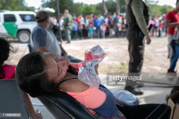 An immigrant from Guatemala ices her shoulder after she was taken into custody by US border agents on July 02 2019 in Los Ebanos Texas She said she...