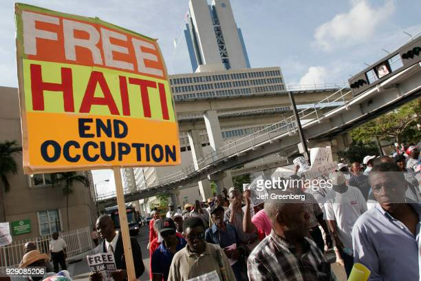 An immigrant Haitians protest about the arrest of activist Gerard JeanJuste in Haiti