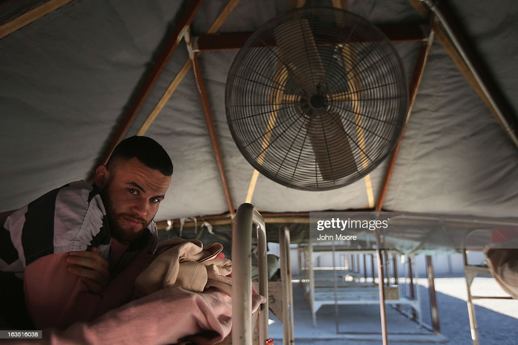 An immigrant inmate rests on his bunk at the Maricopa County Tent City jail on March 11, 2013 in Phoenix, Arizona. The tent jail, run by Maricopa County Sheriff Joe Arpaio, houses undocumented immigrants who are serving up to one year after being convicted of crime in the county. Although many of immigrants have lived in the U.S for years, often with families, most will be deported to Mexico after serving their sentences.