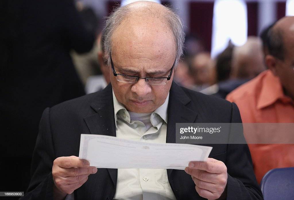 An immigrant looks over his U.S. citizenship certificate following a naturalization ceremony held at the U.S. Citizenship and Immigration Services (USCIS), office on May 17, 2013 in New York City. One hundred and fifty immigrants from 38 different countries became U.S. citizens at the event. Some 11 million undocumented immigrants living in the U.S. stand to eventually gain American citizenship if Congress passes immigration reforms currently being negotiated.