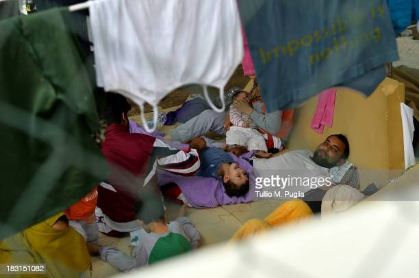 An immigrant mom breastfeeds her baby she and her family are detained after their arrival in the temporary shelter Center on October 5 2013 in...