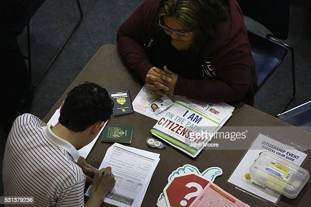 An immigrant receives assistance with her US citizenship application at a Citizenship Now event held by City University of New York on May 14 2016 in...