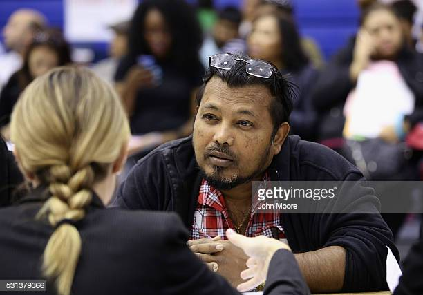 An immigrant receives assistance with his US citizenship application at a Citizenship Now event held by City University of New York on May 14 2016 in...