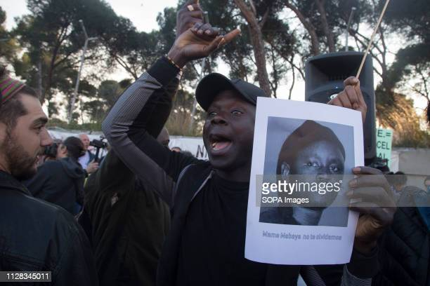 An immigrant seen shouting against Detention Centres for Migrants with a placard during the protest Feminist movement protest as a preparatory action...