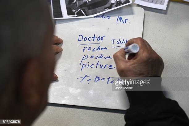 An immigrant takes part in an English as a Second Language class on December 3 2016 at an migrants assistance center in Stamford Connecticut The...