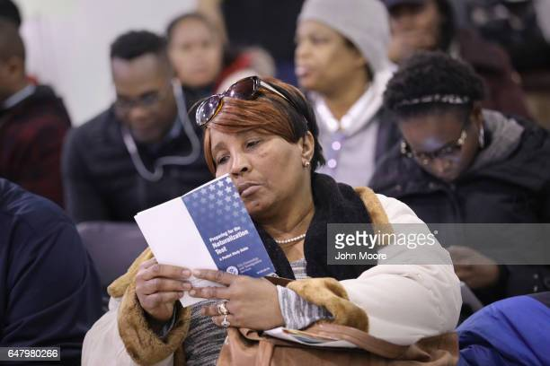 An immigrant wait to receive assistance to complete her US citizenship application at a CUNY Citizenship Now event held in the Bronx on March 4 2017...