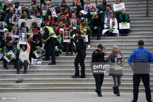 An immigration activist is arrested by US Capitol Police during a protest on the steps of the US Capitol December 6 2017 in Washington DC Activists...