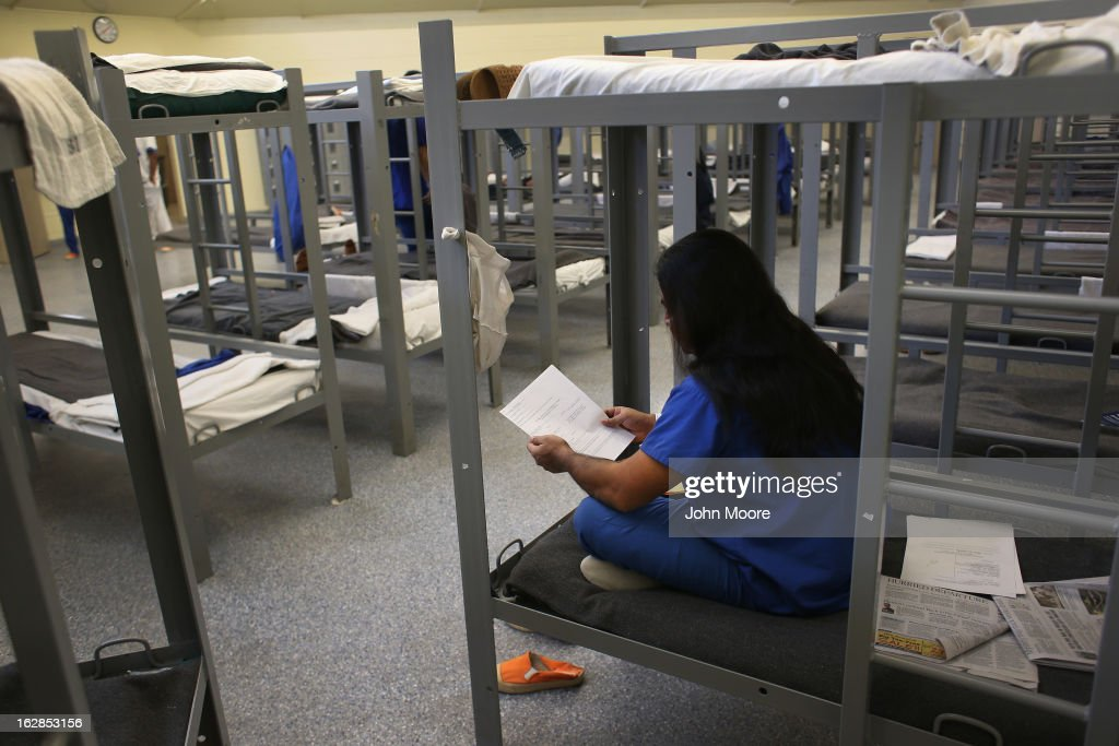 An immigration detainee from Bangladesh reads through his case papers while on his bunk at the Immigration and Customs Enforcement (ICE), detention facility on February 28, 2013 in Florence, Arizona. More than 2,000 immigration detainees remain in ICE custody in the state. With the possibility of federal budget sequestration, ICE released 303 immigration detainees in the last week from detention facilities through outArizona. More than 2,000 immigration detainees remain in ICE custody in the state. Most detainees typically remain in custody for several weeks before they are deported to their home country, while others remain for longer periods while their immigration cases work through the courts.