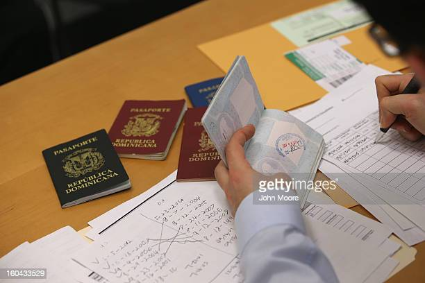 An immigration lawyer sorts through an immigrant's valid and expired passports from the Dominican Republic on January 31 2013 in New York City Lemons...