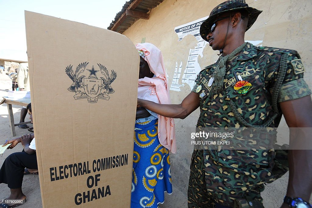 An immigration officer helps a voter at Bole polling station in the northern region on December 7, 2012. Ghana voted in a high-stakes presidential election which is expected to be close, with the emerging country seeking to live up to its promise as a beacon of democracy in turbulent West Africa.