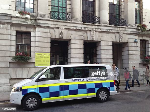 An immigration service van sits outside Camden Registry Office in north London September 22 2014 on the same day that the Minister for Immigration...
