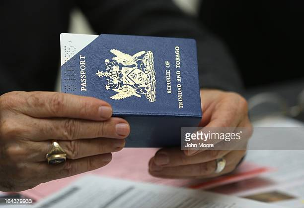An immigration volunteer gives advice while holding a passport during a Citizenship Application Assistance Day event on March 23 2013 in New York...