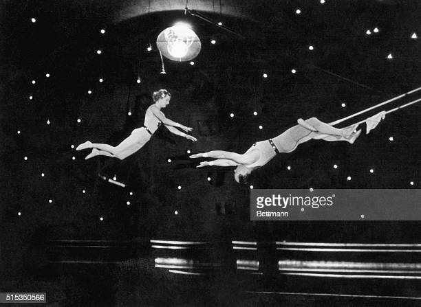 An Imminent Catch Two trapeze artists perform at a circus Undated photograph