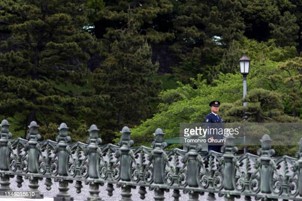 An Imperial Guard officer stands at the Imperial Palace on April 30 2019 in Tokyo Japan Japan's 85yearold Emperor Akihito became the first Japanese...