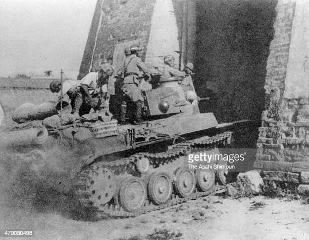 An Imperial Japanese Army tank smashes into the city of Hengyang during the SinoJapanese War circa 1944 in Hengyang China