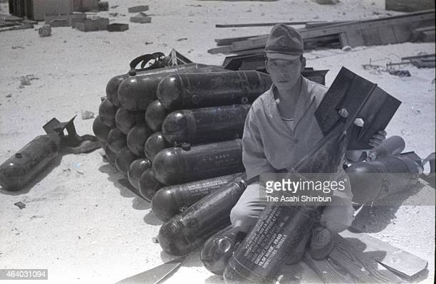 An Imperial Japanese Navy soldier holds a 60 kilogram bomb seized from the United States Army on April 1 1942 in Wake Island United States Wake...