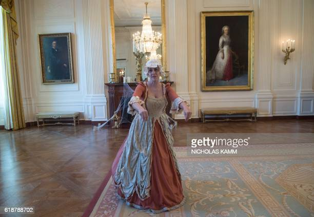 An impersonator of Abigail Adams wife of US President John Adams performs in the East Room of the White House in Washington DC on October 28 2016...
